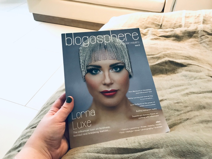 Bex's hand holding the Blogosphere magazine, a publication written by bloggers for bloggers
