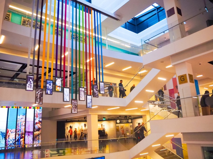 The hanging rainbow ribbon installation in front of the three floors of the museum.
