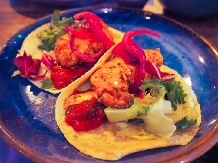 The Chicken tacos - crispy buttermilk chicken with salsa, pickled pink onions and lashings of chipotle sauce.