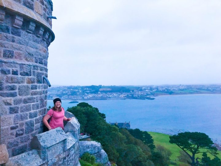 Bex is stood on the very tiny balcony of the turret of St. Michael's Mount castle. The view is out across the Cornish coast.