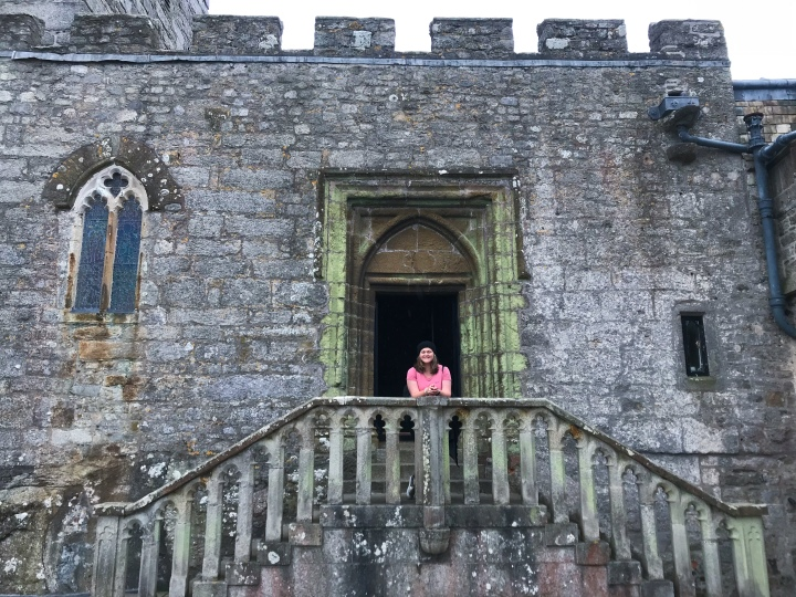 Bex stand on the staircase that leads up to the door of the chapel on St. Michael's Mount.