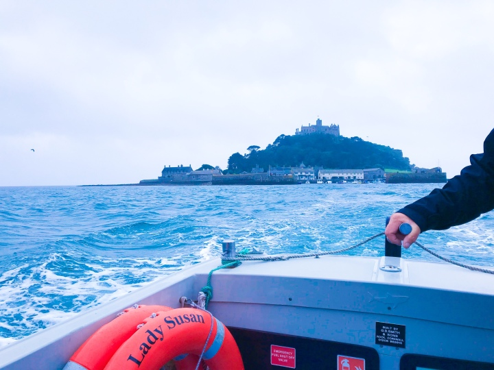 St. Michael's Mount boat trip, the view from the back of the boat with a full view of the island.